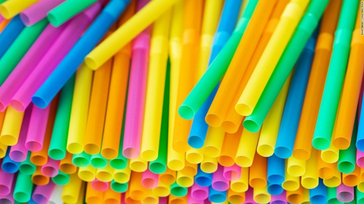 Photograph showing many colourful plastic straws - yellow, orange, green, blue and pink ones