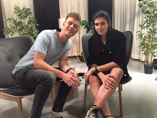 Serena and Caspar Lee pose for a smiling picture on the set of his video.