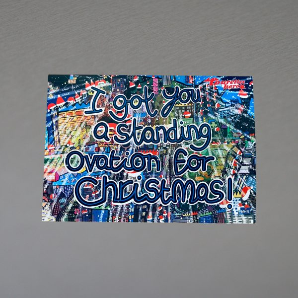 """The image is a Christmas card design, showing a busy London. Across the city little red Santa hats are dotted, and throughout the image in white is the word """"Clap"""". Written across the top of the scene are the words """"I got you a standing ovation for Christmas!""""."""
